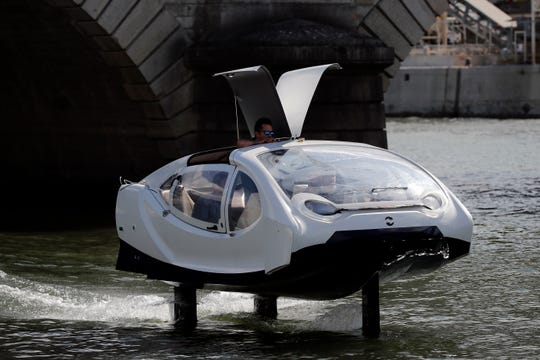 In this photo taken Tuesday Sept. 17, 2019, an hydrofoil boat SeaBubble sails on the Seine river in Paris. Paris is testing out a new form of travel - an eco-friendly bubble-shaped taxi that zips along the water, capable of whisking passengers up and down the Seine River.