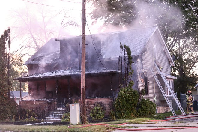 City of Fond du Lac Fire/Rescue crews battle a house fire Thursday, Sept. 19, 2019 at 613 S. Military Road in Fond du Lac, Wis.