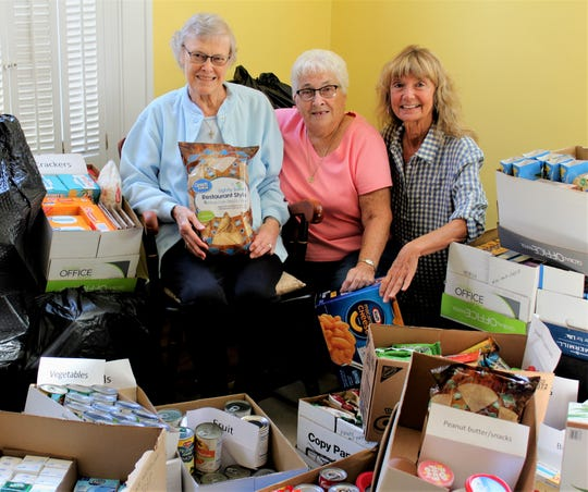 Simple Gestures presented 1,393 items to the St. Vincent DePaul Food Pantry in Port Clinton.
