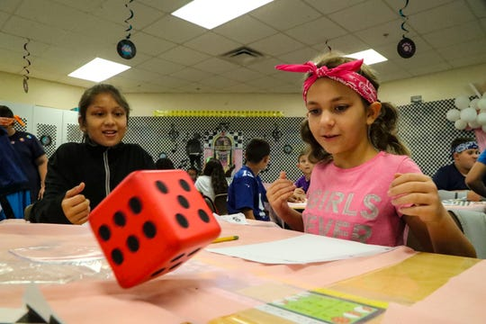 Abby Sardinha, 10, and classmate Natasha Used, 10, roll the dice while working on math. Rock Your School Day at Gulf Elementary in Cape Coral rocked the school. They joined a nationwide effort to promote outside-the-box learning.