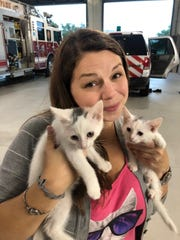 Amber Redfern cuddles some kittens. She and fiance Andrew Townsend are opening Cattyshack Cafe in Gulf Coast Town Center.