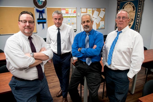 Dennis Lambert, left, Rich Harasym, Matt Alberto and Ed Haras, right, make up the Fort Myers Police Department's Cold Case Unit.