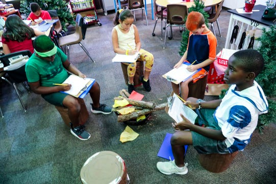 Ritch Desir, 9, Adriana Lima-Gonzalez, 9, Joshua Nipper, 9, and Tyler Lewis, 10, sit around a fake campfire in their classroom as they plan a family vacation to a national park. Rock Your School Day at Gulf Elementary in Cape Coral rocked the school. They joined a nationwide effort to promote outside-the-box learning.
