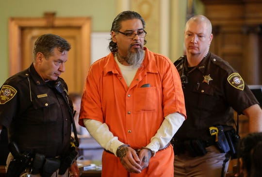 Anthony Kitchenakow is escorted out of a Brown County courtroom Thursday after being sentenced to 40 years in prison in the homicide of Suzette Langlois. Langlois was killed in her Bellevue driveway in 2016.