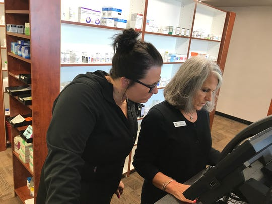 Pharmacy leadership team member Staci Rush, left, works with pharmacy technician Gina Gualtieri behind the prescription counter during the Sept. 18 grand opening for Kewaunee Hometown Pharmacy.