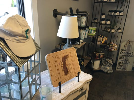 The new Kewaunee Hometown Pharmacy offers a range of gifts, some with a maritime style like this Lake Michigan-themed cribbage board. The pharmacy, which held a grand opening Sept. 18, is one of two retail stores in the city offering fine gifts.