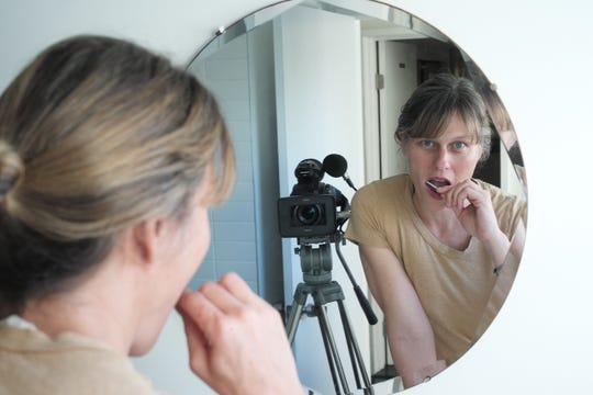 In a scene from her documentary, Sara Lamm swabs her cheek to have her DNA analyzed.