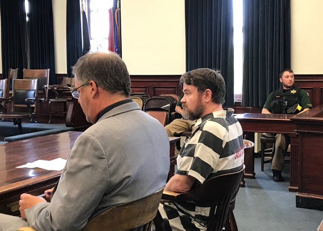 Scott Ellison, right, waits with attorney Carl Jensen Thursday before his sentencing on six counts of sex crimes against children.