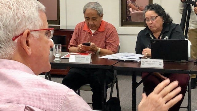 Guam Election Commission member G. Patrick Civille, foreground, addresses the crowd during a Sept. 19, 2019 meeting. Also in photo are commissioner Joseph Mafnas and executive director Maria Pangelinan.