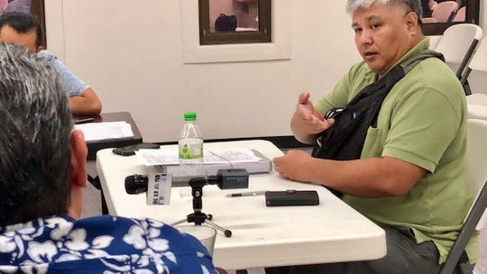 Dededo resident John Ralph Duenas Cruz, right, gestures as he addresses the Guam Election Commission during their Sept. 19, 2019 meeting.