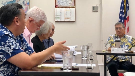 Guam Election Commission counsel Vincent Camacho, left, gestures as he addresses commissioners led by Chairman Michael Perez, right, during a Sept. 19, 2019 meeting.
