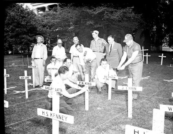 Members of the American Legion  erecting crosses bearing the names of deceased Henderson County servicemen for a Memorial Day display in 1956 sponsored by Worsham Post 40. The American Legion first erected crosses  in 1941 and 1942, according to The Gleaner of May 30, 1941, and June 2, 1942, although it did not become an annual Memorial Day tradition until 1946. Worsham Post 40 was formed in 1919.