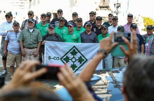 A group of Vietnam War veterans from B Company, 2nd Battalion, 8th Infantry Regiment of the 4th Infantry Division pose for a photo at the Soldiers and Sailors Monument while touring Indianapolis' war monuments and memorials together, Thursday, Sept. 19, 2019.