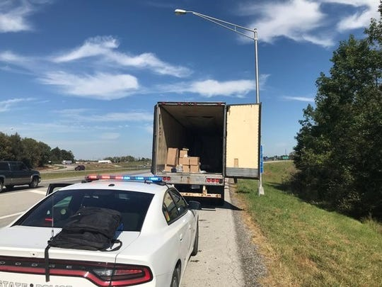 Indiana State Police seized hundreds of pounds of cocaine and marijuana and arrested a driver after stopping a semi-tractor trailer on I-70 near Monrovia Wednesday.