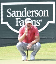 Tom Hoge lines up his birdie putt on the 18th hole at the Sanderson Farms Championship on Thursday, September 19, 2019, at the Country Club of Jackson in Jackson, Miss.