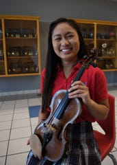 Elisa Kapunan is semifinalist in the National Merit Scholarship Program. Mahajan is a senior at the University School of Jackson. She's played the violin since she was 4-years-old and continues to play the violin in her school's orchestra  group.