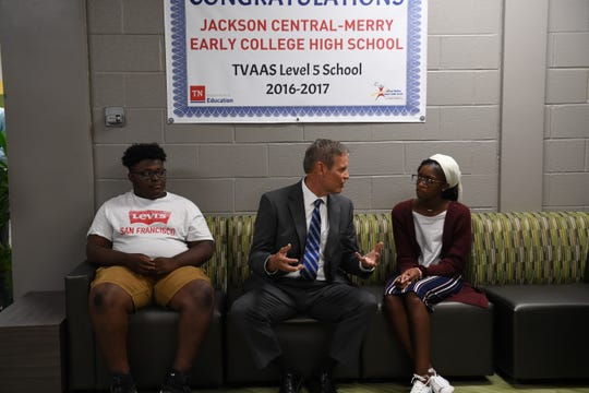 Jackson Central-Merry Early College High students Patrick Davis and Da'Niya Jones talk with Gov. Bill Lee at the school on Wednesday.