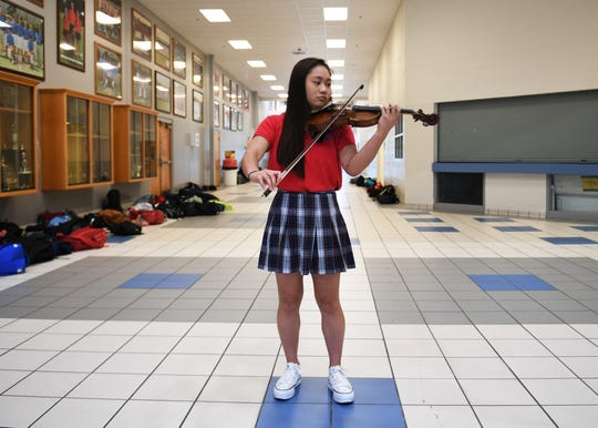 Elisa Kapunan is a semifinalist in the National Merit Scholarship Program. Mahajan is a senior at the University School of Jackson. She's played the violin since she was 4-years-old and continues to play the violin in her school's orchestra  group.