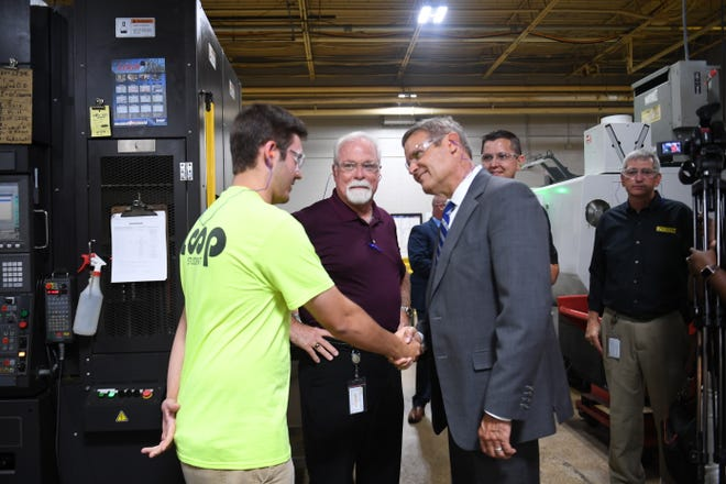 Hardne Lane shakes hands of Gov. Bill Lee after being introduced by Tim McClendon. at Stanley Black & Decker in Jackson, Tenn., Wednesday, Sept. 18, 2019.