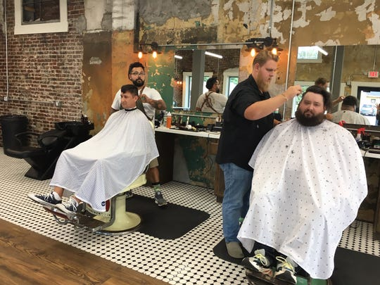 Gabriel Huber and Cody Veals get spiffed up by expert barbers John Michael Rodriguez and Spencer Bailey. Rodriguez and Huber are military veterans. Sept. 10, 2019.