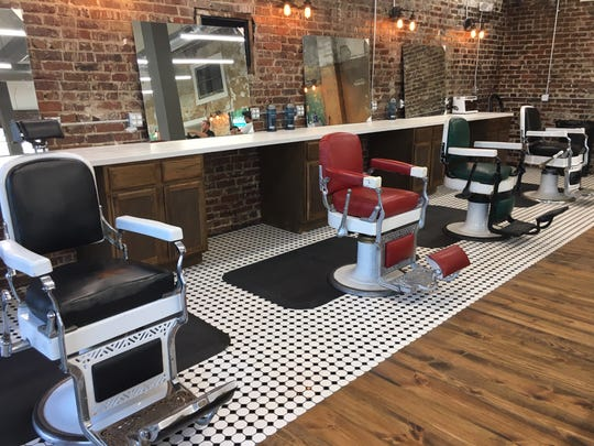 "The hexagonal penny-tile floor, wide hardwood flooring and — most of all — authentic historical barber chairs give Saints & Sailors its ""old-fashioned barbershop"" feeling."