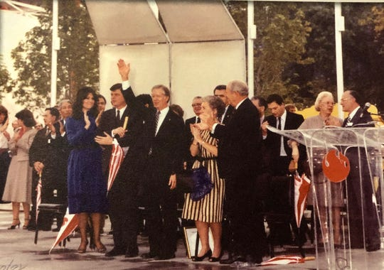Former president Jimmy Carter waves to the crowd during a 1982 World's Fair event.