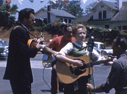 A young Dolly Parton, center, performs as part of a WIVK live remote in Fountain City around 1960. The image comes from recently discovered film preserved by Brad Reeves and the Appalachian Media Archives.