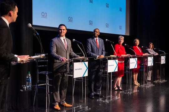 "Jim Hummel of KATC-TV3, far left, moderates a ""Jeopardy!""-style forum for Lafayette mayor-president candidates (from left) Josh Guillory, Carlos Harvin, Nancy Marcotte, Simone Champagne, and Carlee Alm-LaBar Wednesday, Sept. 18, 2019."