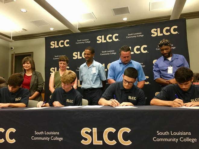 St. Martin Parish students sign commitments to take classes in the new Collegiate Technical Academy started this semester through a partnership between St. Martin Parish School Board and South Louisiana Community College.