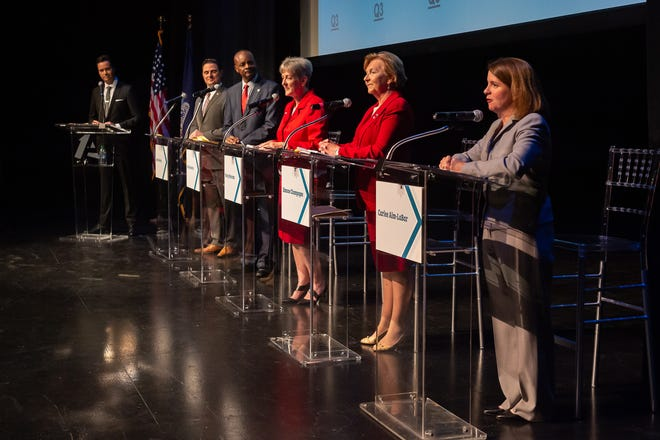 """Jim Hummel of KATC-TV3, far left, moderates a """"Jeopardy!""""-style forum for Lafayette mayor-president candidates (from left)  Josh Guillory, Carlos Harvin, Nancy Marcotte, Simone Champagne, and Carlee Alm-LaBar Wednesday, Sept. 18, 2019."""
