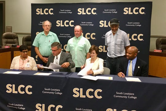 St. Martin Parish School Board and South Louisiana Community College officials sign a partnership to create the Collegiate Technical Academy Sept. 18.