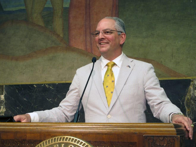 In this June 6, 2019 file photo, Louisiana's Democratic Gov. John Bel Edwards smiles as he describes the end of a legislative session that saw his teacher pay raise and education spending plans win final passage, in Baton Rouge. Edwards moved quickly to expand Medicaid when he took office in 2016.