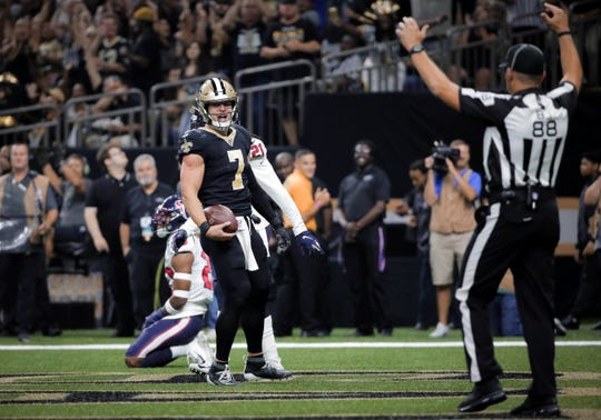 Sep 9, 2019; New Orleans, LA, USA; New Orleans Saints quarterback Taysom Hill (7) celebrates after a touchdown against the Houston Texans during the third quarter at the Mercedes-Benz Superdome. Mandatory Credit: Derick E. Hingle-USA TODAY Sports