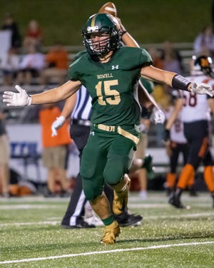 Peyton Ward celebrates one of his three interceptions in Howell's 27-14 victory over Northville on Friday, Sept. 13, 2019.