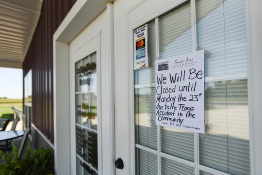 Signse seen at Sunset Acres Coffee Shop Bakery near Chester Township, Michigan, Thursday, Sept. 19, 2019 say the shop was closed a day after three Amish siblings within the community were killed when their horse-drawn cart was hit by a motor vehicle. A fourth sibling was injured.
