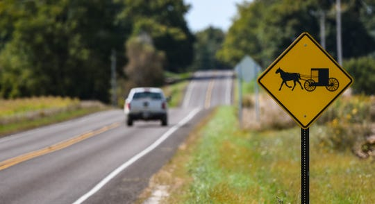 Signs near Vermontville Highway and M-50 in Charlotte on Thursday, Sept. 19, 2019, warn of horse-drawn vehicle traffic. Three three Amish siblings died when their horse-drawn cart was struck by a vehicle near Bradley Road.  The four children were ages 6 to 13. The  6-year-old, was critically injured but is now in stable condition, police said Thursday.
