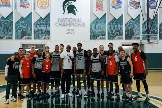 Members of the Michigan State basketball team stand with Magic Johnson at the Pentecost Practice Facility on Thursday, Sept. 19, 2019. Some of the players in the photo are Conner George, Jack Hoiberg (No. 1), Cassius Winston (No. 5), Kyle Ahrens, Xavier Tillman, Braden Burke, Marcus Bingham Jr. (No. 30), Aaron Henry, Thomas Kithier (No. 15), Brock Washington (No. 2), Joshua Langford, Foster Loyer (No. 3) and Gabe Brown (No. 5).