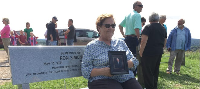 Helen Eckenrode, a close friend of Ron Simon, sits on Simon's bench atop Mount Jeez  in 2017 during the dedication ceremony.