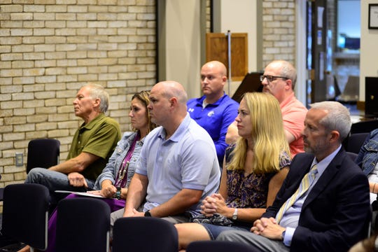 Ontario School Board Members Sam VanCura, far left, Heidi Zimmerman, second from right, and Todd Friend, far right, attend Ontario City Council's meeting on Wednesday night.