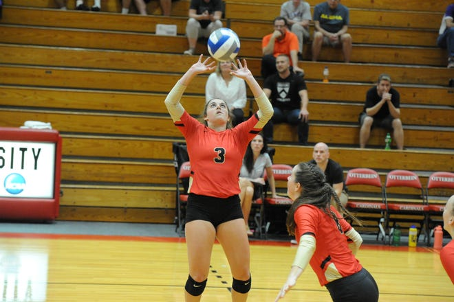 Only a freshman on the Otterbein volleyball team, Pleasant grad Carlie Craycraft sets to a teammate during Wednesday's 3-0 win over Kenyon. Craycraft leads the Ohio Athletic Conference in assists per set and is 14th in the country in NCAA Division III.