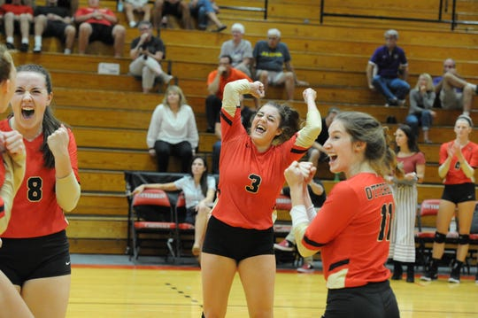Pleasant grad Carlie Craycraft (3) celebrates with her Otterbein teammates during a 3-0 home win over Kenyon Wednesday night in the Rike Center. The Cardinals were 13-1 after the victory.