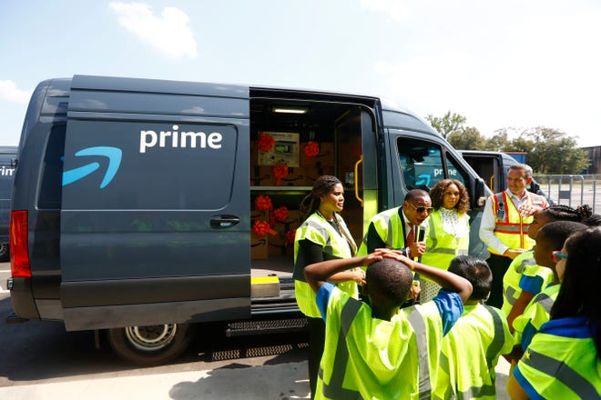 Shelby County School Superintendent Joris Ray helps Amazon surprise children from Getwell Elementary School with a donation of $10,000 of STEM supplies during the grand opening of Amazon's Memphis delivery station facility on Thursday, Sept. 19, 2019.