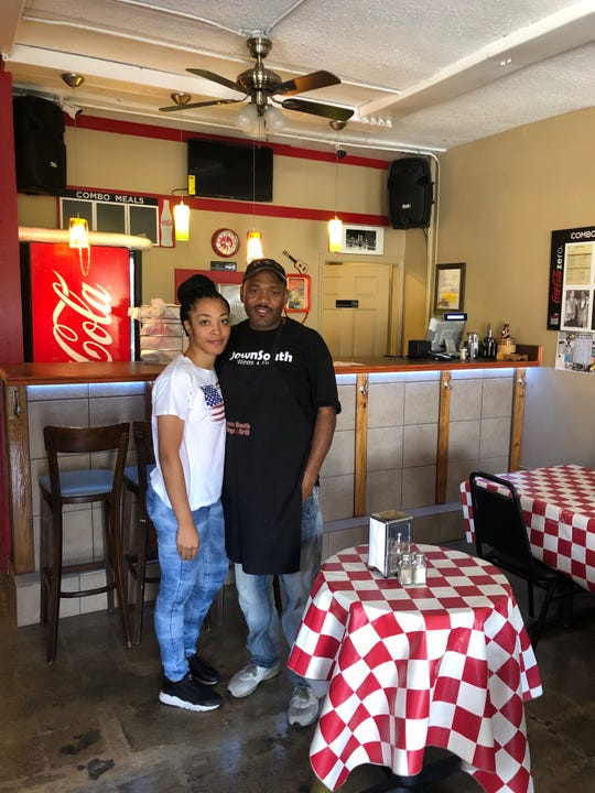 Ray Allen and his daughter Rayvin. Allen is the owner and chef of Down South Wings & Grill on Florida St.