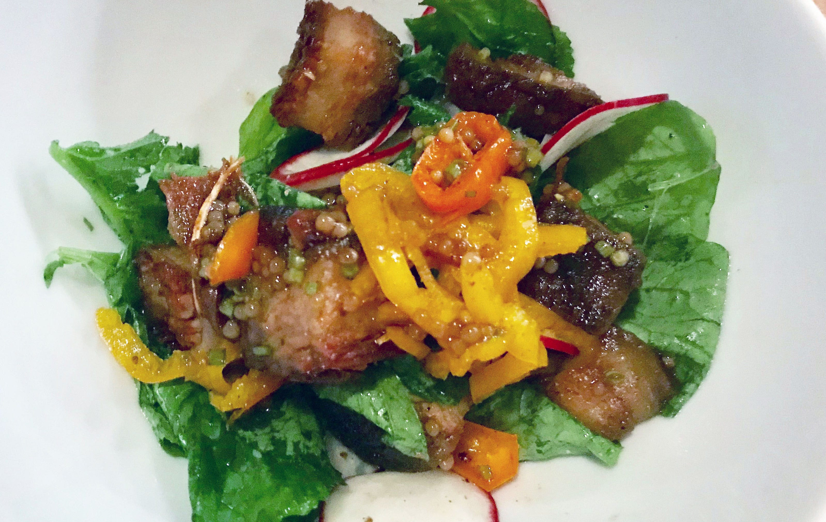 A salad in June at Amilinda, 315 E. Wisconsin Ave., combined all delicious things: sweet peppers, white honey, fried pork belly, pickled mustard seed and the season's radishes.