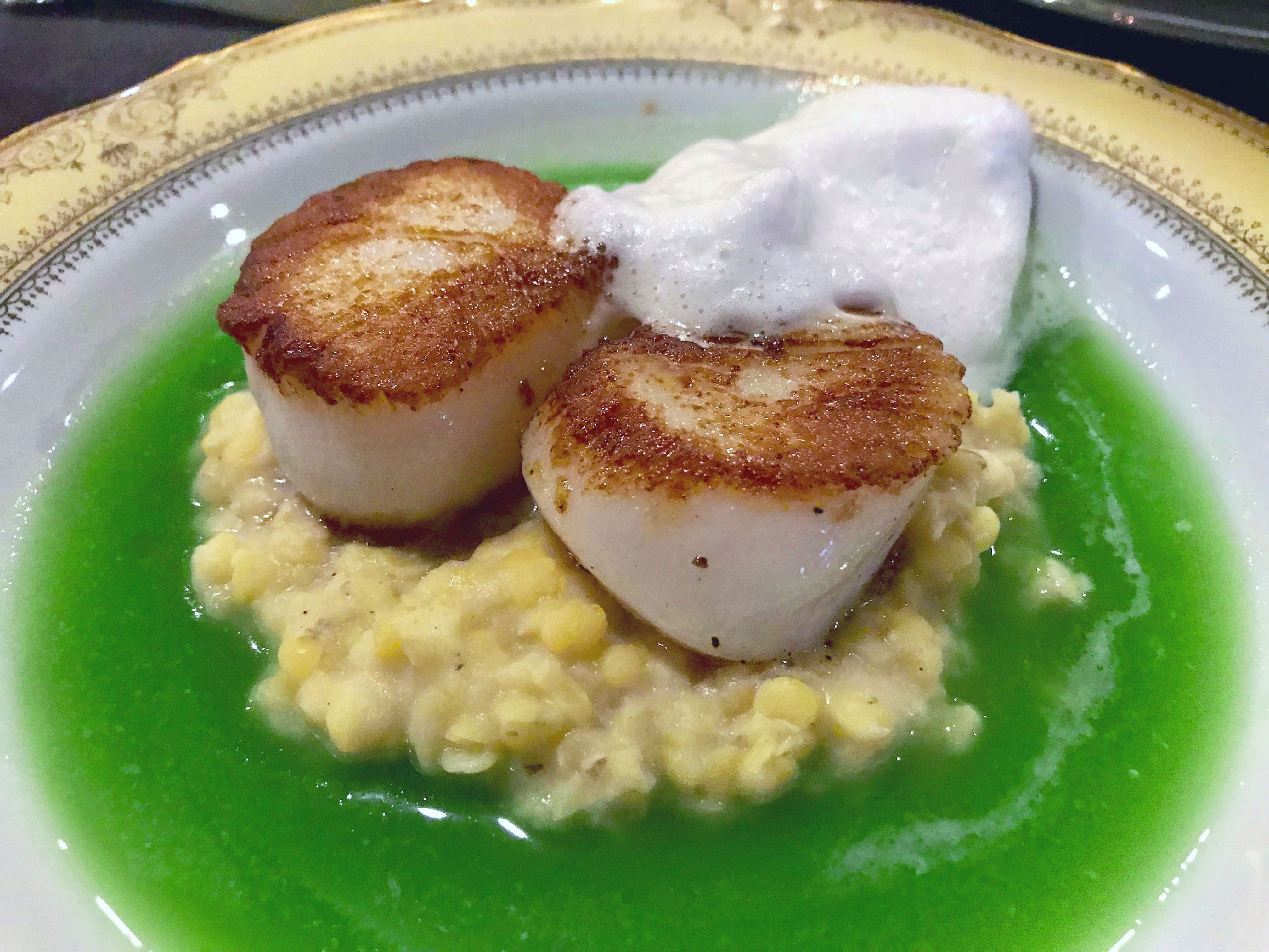 Large, sweet scallops were served over lentils and parsnip puree in mint and snow pea broth, and garnished with spruce-tip foam in early summer at Meraki, 939 S. Second St.