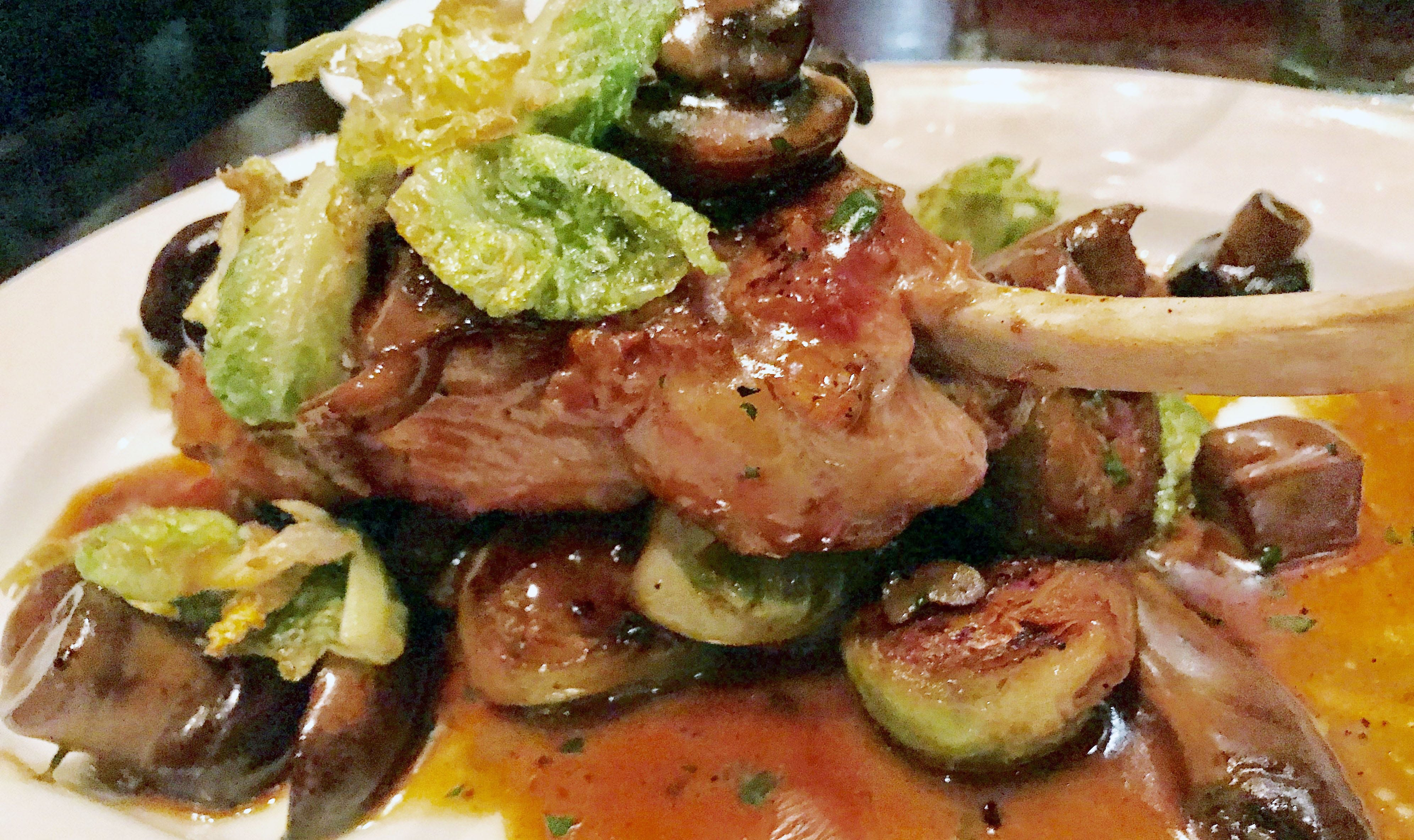 Besides steaks, Carnevor serves composed dishes like this bone-in veal chop with mushrooms and brussels sprouts.