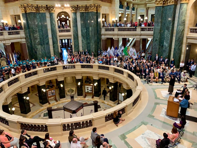 Superintendent of Public Instruction Carolyn Stanford Taylor, right, in blue, delivers her first State of Education speech in the Wisconsin Capitol Rotunda on Thursday.