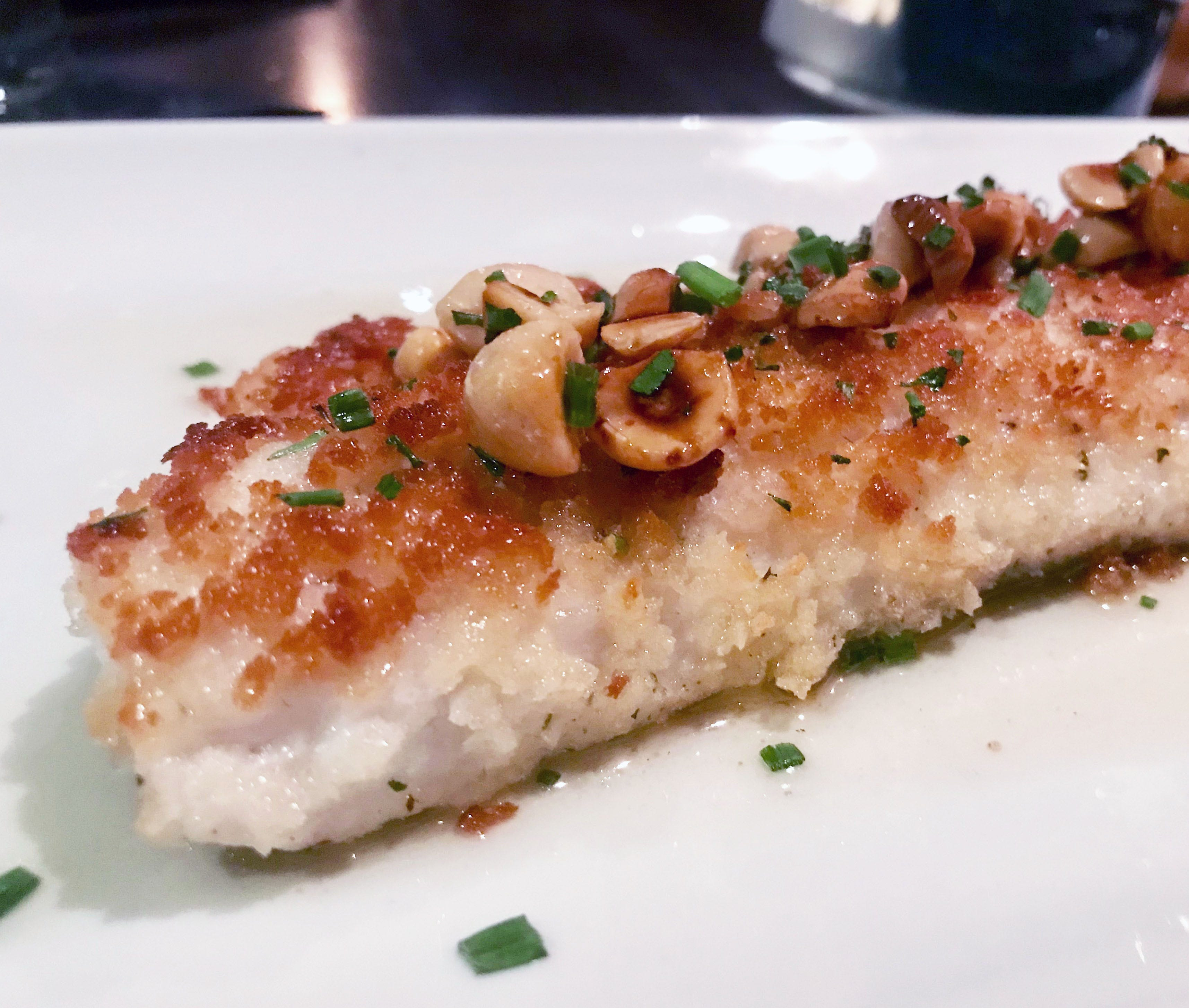 Walleye is crusted in panko crumbs and topped with hazelnuts at Jake's in Pewaukee. Lemon-butter sauce accompanies it.