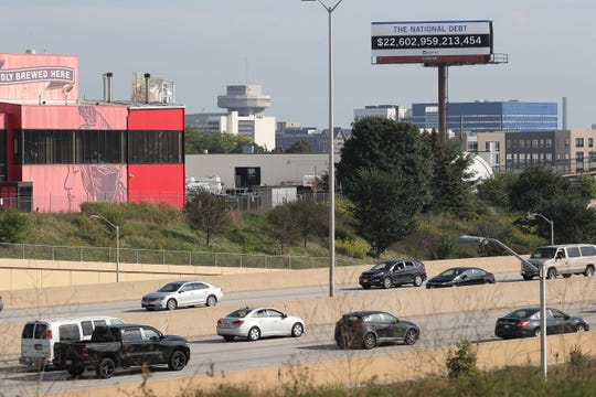 A debt clock billboard in Milwaukee is visible to freeway commuters just north of downtown. The billboard, paid for by the Peter G. Peterson Foundation in New York, was erected to call attention to the rising national debt.