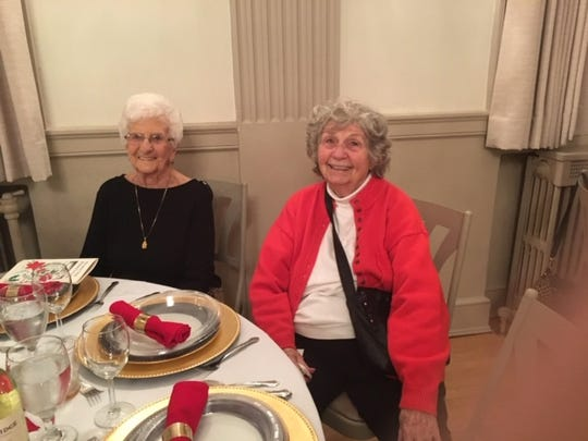 Wauwatosa Woman's Club members Beverly Gleisner and Marie Dennison sit during an event. The two became friends through the club in 1960. They remain best friends today.